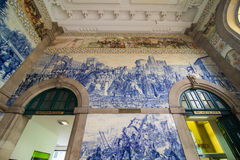 Porto, Portugal - July 2017. Ancient vintage azulejos picture in the old Sao Bento Railway Station of Porto. Building of Sao Bento. Ancient vintage azulejos Stock Photos