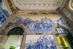 Porto, Portugal - July 2017. Ancient vintage azulejos picture in the old Sao Bento Railway Station of Porto. Building of Sao Bento Stock Photos