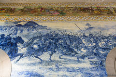 Ancient vintage azulejos picture in the old Sao Bento Railway Station of Porto. PORTO, PORTUGAL - DEC 25, 2016: Ancient vintage azulejos picture in the old Sao Stock Images