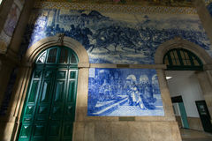 Ancient vintage azulejos picture in the old Sao Bento Railway Station of Porto. Stock Image