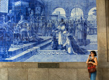 Ancient vintage azulejos picture in the old Sao Bento Railway Station of Porto. Royalty Free Stock Photography