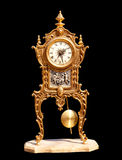 Ancient vintage brass pendulum clock Royalty Free Stock Photography
