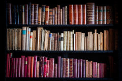 Ancient vintage library knowledge. Shelves of historical books. Stock Photo