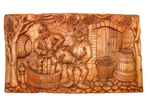 Ancient vintage wooden Bas-relief about vine manuf Stock Photography