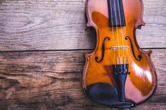 violin on a table of rough boards stock image