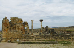 Ancient Volubilis town ruins, arch and column Stock Photo
