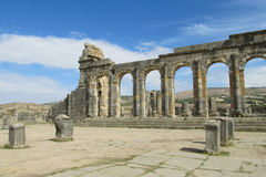 Ancient Volubilis town ruins, arch and columns stock photo