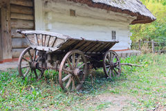 Ancient wagon Ukrainian peasants near the house Royalty Free Stock Images