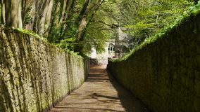 An ancient walkway leading to the ruin of an old church in Devon England. A walkway used bu churchgoers in England for centuries. Taken in the countryside of stock photos