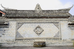 Ancient wall with bas-relief of Chinese mansion Stock Photography