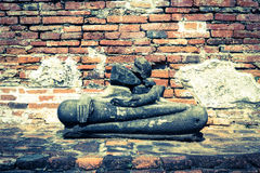 Ancient wall with broken Buddha statue,vintage color Stock Image