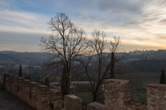 Ancient wall of Certosa di firenze and Tuscan landscape on background. Italy. stock photography