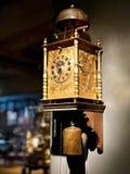 An ancient wall clock. Close-up on an ancient clock stock photos