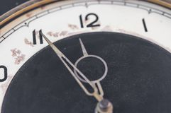 Five to twelve, time on vintage clock. Isolated from background Royalty Free Stock Photo