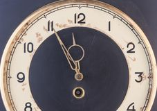 Five to twelve, time on vintage clock. Isolated from background Stock Photography