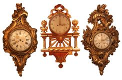 Ancient wall clocks with wooden structure Stock Image
