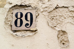 Ancient wall with the house number - Salento Italy. Old wall with the house number on a nail and plaster ruined - Salento Italy Stock Photography