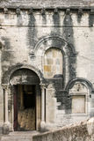 Ancient wall of limestone with arched windows Royalty Free Stock Images