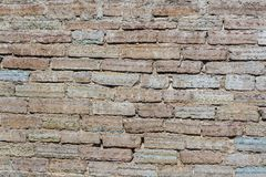 Ancient wall of red brick. stock image