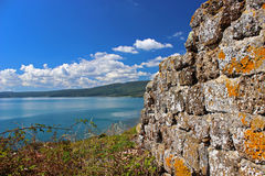 The ancient wall in the sea Stock Photography