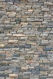 Ancient wall from slim granite brick. Stock Photo