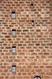 Ancient wall with small windows displayed Royalty Free Stock Photos