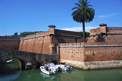 Ancient walls. On the river in Livorno Stock Photos