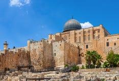 Ancient walls and Al Aqsa Mosque dome in Jerusalem, Israel. Ancient walls and Al Aqsa Mosque dome under blue sky in Jerusalem, Israel Stock Image