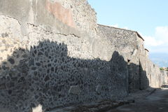 Ancient walls. Architecture of ancient buildings dating back to the ancient Romans found in the archaeological excavations of Pompeii site of so much tourism stock image