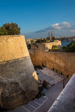 Ancient walls and bastions of Valetta fortress in late afternoon. Lights. Malta Royalty Free Stock Image