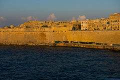Ancient walls and buildings of Valetta fortification in the even Royalty Free Stock Images
