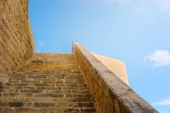 Ancient walls of Citadel, Victoria, Malta. Victoria, Gozo. Ancient walls of Citadel built of limestone with long stairway Stock Images
