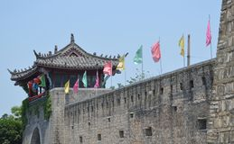 Ancient walls of Sanhe Ancient Town. The wall and flags in Sanhe Ancient town, China during May celebrations. Picture taken May 2014 Royalty Free Stock Images