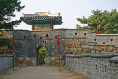 The ancient walls of Suwon city,South Korea. The ancient city walls of Hwaseong Fortress, and a gate house, Suwon. South Korea. A UNESCO World heritage Site Stock Photography