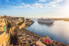 The ancient walls of Valletta and Malta harbor with cruise ship in the morning - Malta royalty free stock photos