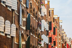 Ancient warehouses in the city of Amsterdam Stock Images