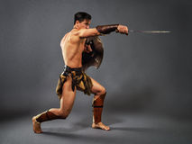 Ancient warrior. Blow with a sword Royalty Free Stock Photography