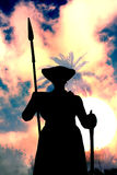 Ancient Warrior Guard. A silhouette of an ancient Indian warrior guard with a spear, on the backdrop the dusky sky Stock Photography