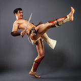 Ancient warrior.  kick. Stock Photo