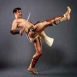 Ancient warrior.  kick. Stock Photo