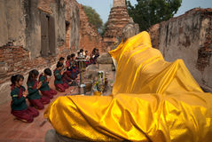 Ancient warrior make a pilgrimage to Reclining Buddha. Stock Photography