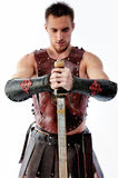 Ancient warrior with sword on white background Stock Photo