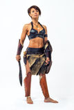 Ancient warrior woman. Beautiful athletic woman in the image of the warrior of the ancient world on white background Stock Photography