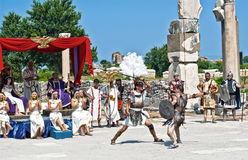 Ancient warriors. In the ancient city of Ephesus, local actors and dancers present a spectacular show for visitors. The actors,  dressed in ancient fighters Royalty Free Stock Photography