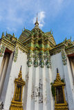 Ancient Wat Pho Temple with blue sky , Bangkok in Thailand Stock Photo