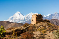 Ancient watch tower with mountain scenery. Stock Photo