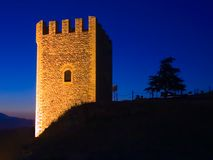 An ancient watchtower at night. An ancient watchtower royalty free stock images