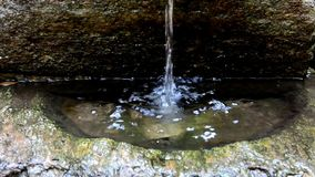 Ancient water fountain. stock video footage
