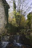 Ancient water mill and house, Ain river, Jura, france Royalty Free Stock Photography