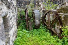 Ancient water-mill. Ruin of a bakery and water-mill equipment in Vic-sur-Cere, France Royalty Free Stock Images